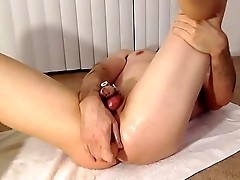 Guy in chastity plays with a thick 16&quot_ long dildo