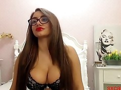beautiful girl with glasses plays with pussy on webcam